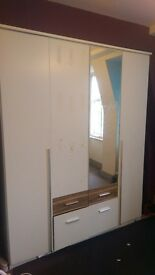 WHITE 4 DR CUPBOARD