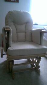 Rocking recliner nursing chair in natural wood