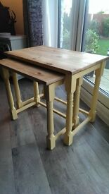 nest of two pine tables