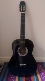 Black acoustic guitar (w/ capo and picks)