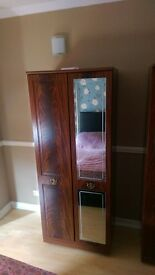 2 wooden cupboards with glass mirror.