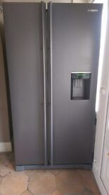 American fridge freezer with water dispenser. Used but in very good condition.