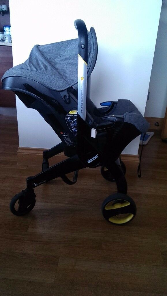 Doona Car Seat (Grey) WITH Iso-fix and several accessories