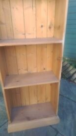 Tall pine book case. Good condition. Excellent bargain.