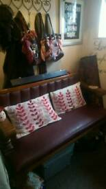 Leather bench with the metal studs