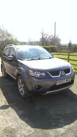 7 seater 4x4 Mitsubishi Outlander, 6 gears, high mileage, excellent condition, MOT till Dec.