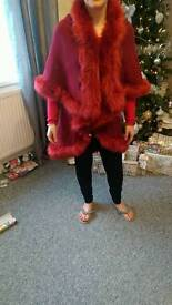Fur trimmed red cape