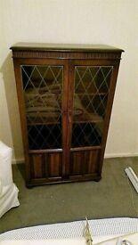dark wood glassed fronted wooden cabinet (make me a senible offer)