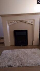 Alabaster, cream fire surround and electric fire