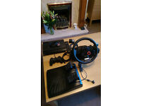 Sony PS3 500Gb Super Slim, wheel and games
