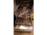 Electrolux integrated dishwasher with a maple effect kitchen door