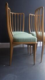 A vintage set of four 1950s Mahogany dining chairs by Paolo Buffa