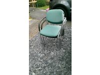 Two metal chairs with soft seat and back