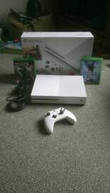 Xbox one s with two games.