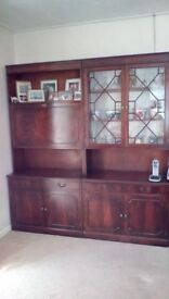 2 large dark wood display units