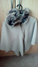Lovely cosy poncho, fur hood as new condition.