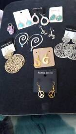 Ten pairs earrings New to clear