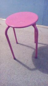Bright pink metal stool