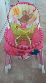 Pink musical baby rocking chair