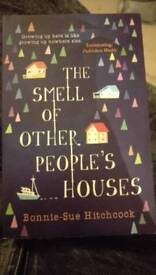 The smell of other people's houses. Good as new book.