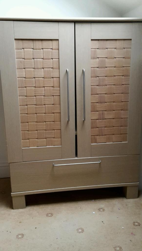 Lovely cupboard with lattice design to doors beech