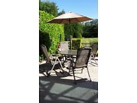 Table, parasol & reclining chairs