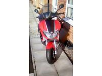 Registered as 125 but bored out to 185 has heated grips and a sports exhaust also with it.