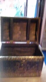 Wooden chest with brass covering