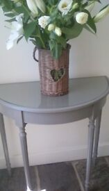 A gorgeous painted half moon table