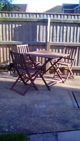 Wooden table and three chairs