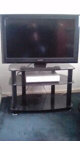 Sony Bravia Flatscreen with Skybox, Remotes and stylish stand