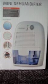 BRAND NEW DEHUMIDIFIER IN SEALED BOX.