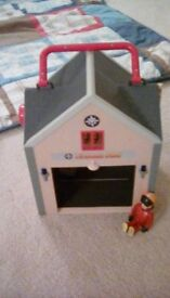 Fireman Sam firestation with figurine and soft toy.