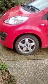 Peugeot 107,998c, 5 door, red, 6 months mot,52,000 miles,£0 tax, tinted rear window,s, b