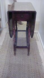 A British oak gateleg table in the Charles II style.