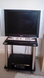 20inch humax tv, and sony dvd player,on a smoke glass table stand.