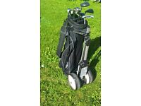 Left Handed half set of clubs, bag and trolley
