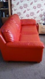 Red leather sofas 2 x 3 seater