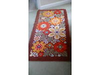 Hand made rug. Clean. Browns, greens,reds,orange,white. 70 x 137cm.