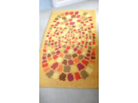 Hand made rug. Clean condition. Yellow, brown, green. 70 x 137 cm.