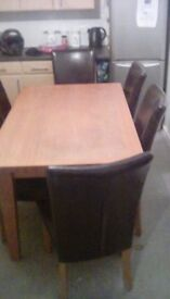 Solid oak table and 6 leather chairs oldham