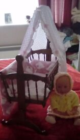 Dolls rocking cradle and doll