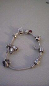 Genuine Pandora silver bracelet with 7 charms.