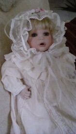 Beautiful doll and basket in a victorian style, porcelain hands face and legs