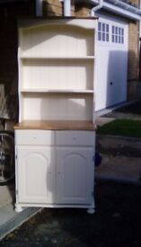 Solid pine wood Welsh 2 door dresser. Painted in cream with waxed natural tops