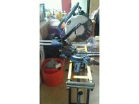 Double bevel sliding mitre saw with base stand