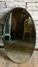 Vintage bevel edged oval wall mirror
