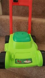 CHILDRENS toy lawn mower excellent conditio