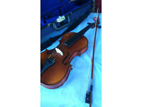 Violin, plus soft case, bow and chin rest. Excellent condition. Full size.