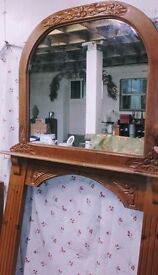 Over mantle mirror and matching fire surround